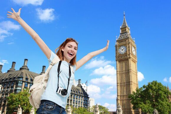 bigstock-Happy-Travel-Woman-In-London-87682889